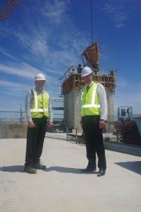 Brookfiled Multiplex Regional Director Steve McConkey and Murdoch Hospital CEO John Fogarty observe the final pour at the top of the South Wing.