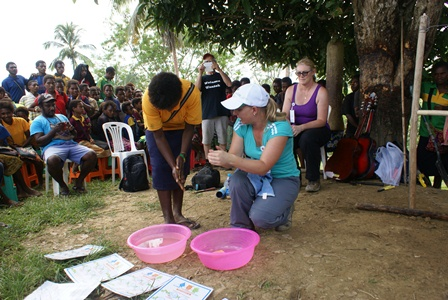 Jodie demonstrating hand washing techniques on International Hand Hygiene Day.