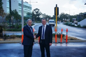 Image: Dr Mark and Mr Fogarty at the puffin crossing that links the two hospitals.
