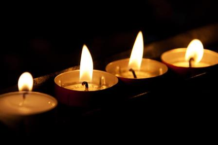 4-burning-candles-in-the-dark